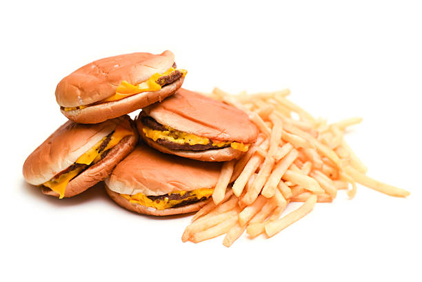 fast food cheeseburgers and french fries - fast food restaurant stock pictures, royalty-free photos & images