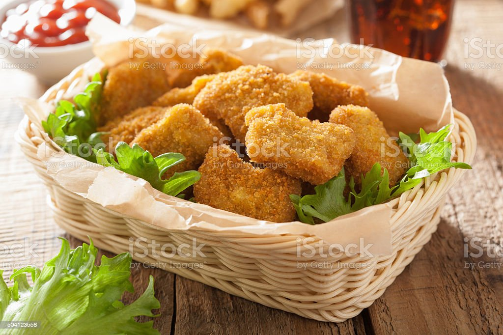 fast food chicken nuggets with ketchup french fries cola stock photo