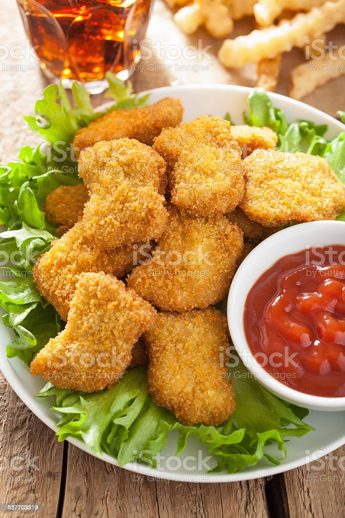 fast food chicken nuggets with ketchup, french fries, cola stock photo