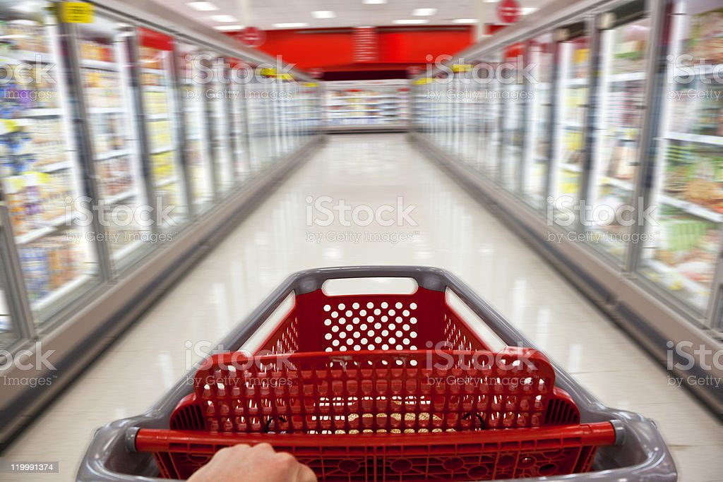 Fast Food Concept Motion Blur Shopping Trolley in Supermarket royalty-free stock photo