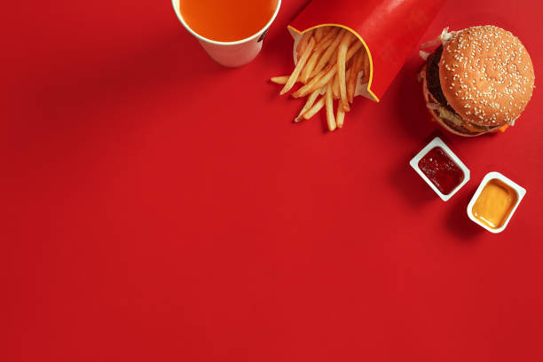 fast food dish top view. meat burger, potato chips and glass of drink on red background. takeaway composition - fast food restaurant stock pictures, royalty-free photos & images