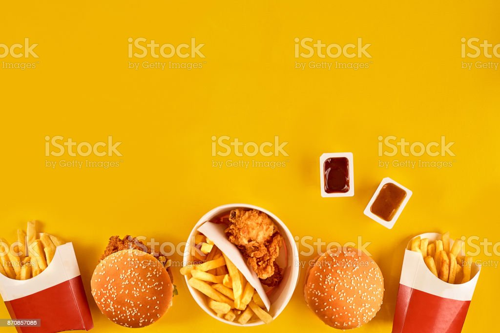 Fast Food Dish Top View Meat Burger Potato Chips And Wedges Take Away Composition French Fries Hamburger Mayonnaise Ketchup Sauces On Yellow