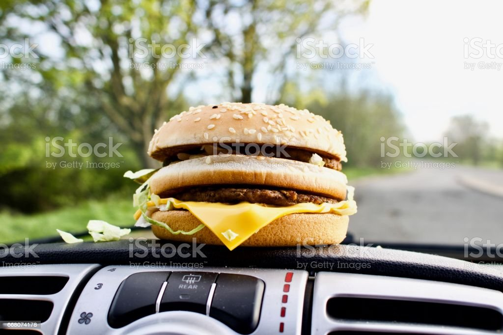 Fast food in car stock photo