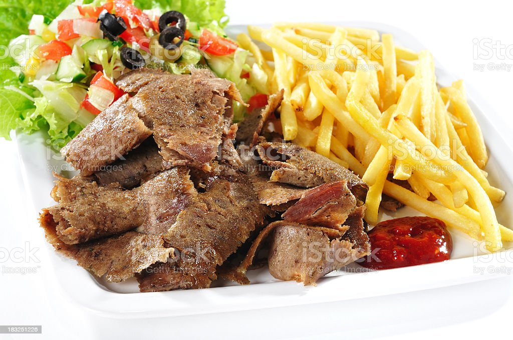 Fast food, kebab with french fries and ketchup on plate stock photo
