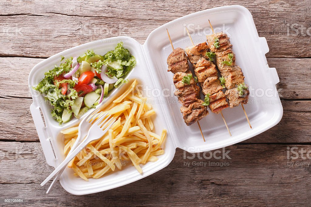 Fast food: kebabs, fries and fresh salad in tray. horizontal stock photo