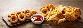 istock fast food meals : onion rings, french fries, chicken nuggets and fried chicken 1225629111