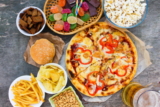 Fast food on old wooden background. Concept of junk eating. Top view. Fast food on old wooden background. Concept of junk eating. Top view. unhealthy eating stock pictures, royalty-free photos & images
