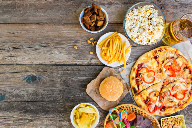fast food on old wooden background. concept of junk eating. top view. - fast food restaurant stock pictures, royalty-free photos & images