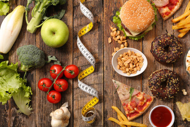 fast food or health food fast food or health food unhealthy eating stock pictures, royalty-free photos & images
