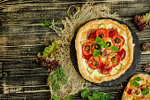 istock Fast food pizza italian traditional on wooden table 1008257432