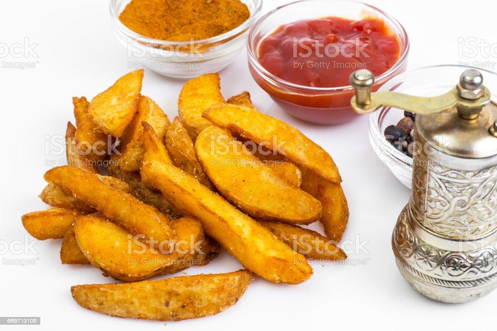 Fast food, potato slices on white background stock photo