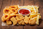 istock fast food products: onion rings, french fries and chicken nuggets 1090835104