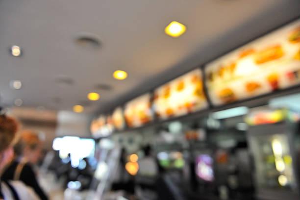 Fast food restaurant interior menu bokeh background stock photo