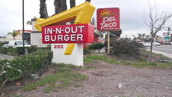 Fast food restaurants. In-n-out Burger drive thru, Del Taco logo, California USA