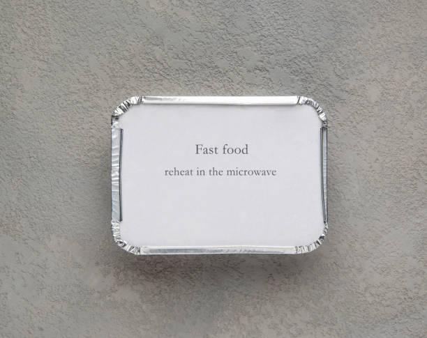 fast-food-set - alufolie backofen stock-fotos und bilder