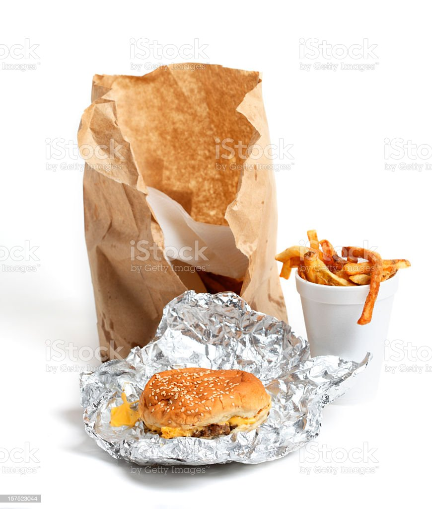 Fast food take out with cheeseburger and fries stock photo