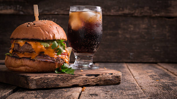 fast food with burger or cheeseburger, and soft drink stock photo