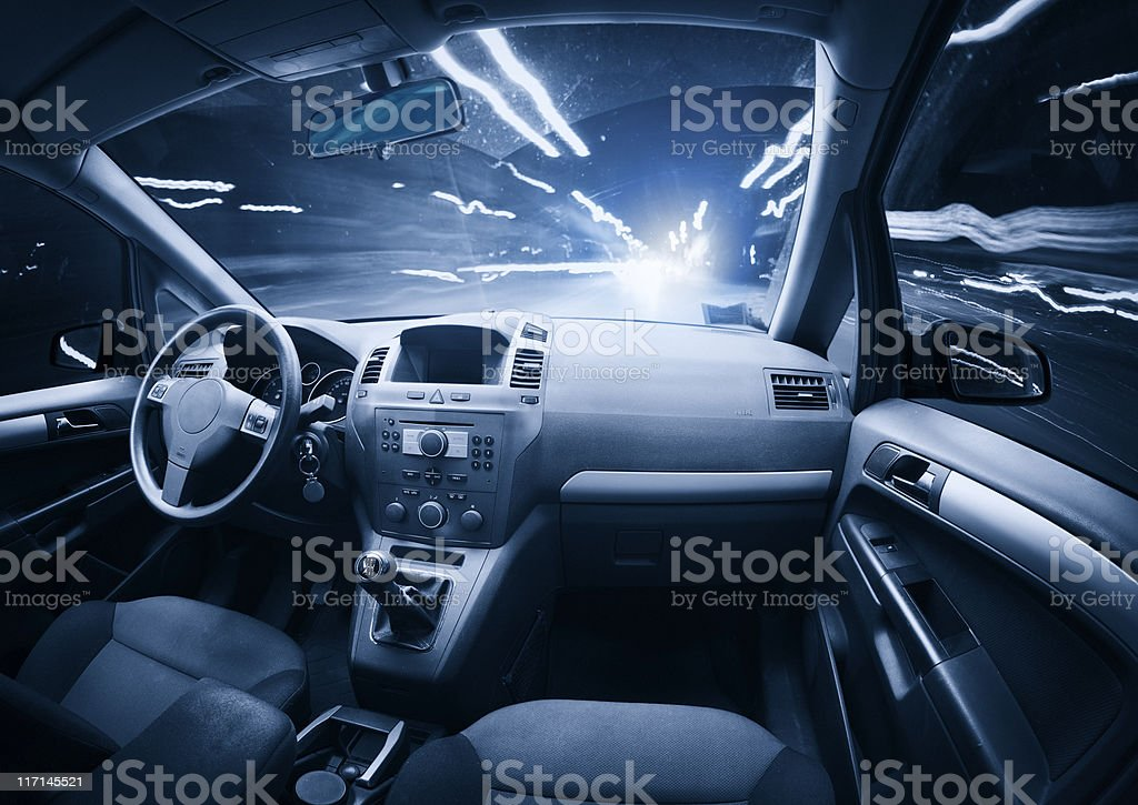 Fast ghost car into the light traffic. stock photo