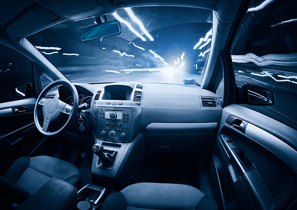 fast ghost car into the light traffic. - car interior stock photos and pictures