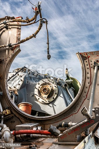 Mechanical workings and close up detail of a decommissioned fast jet internals.
