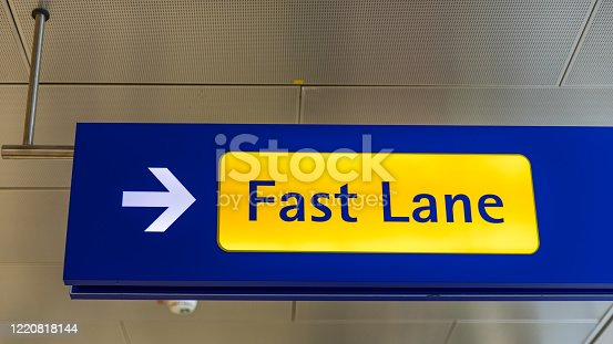 Fast Lane sign in blue and yellow at the airport close up. Fast Lane sign airport first class luxury notification.