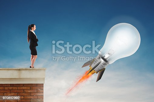 istock Fast lightbulb as a rocket ready to fly fast. Concept of new super idea 970852992