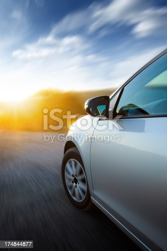 Dynamic shot of car riding to the sun