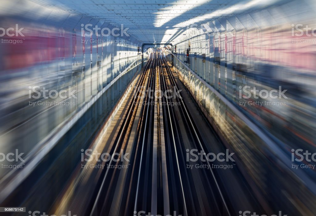 Fast motion zoom effect in a tunnel with train tracks background NYC stock photo