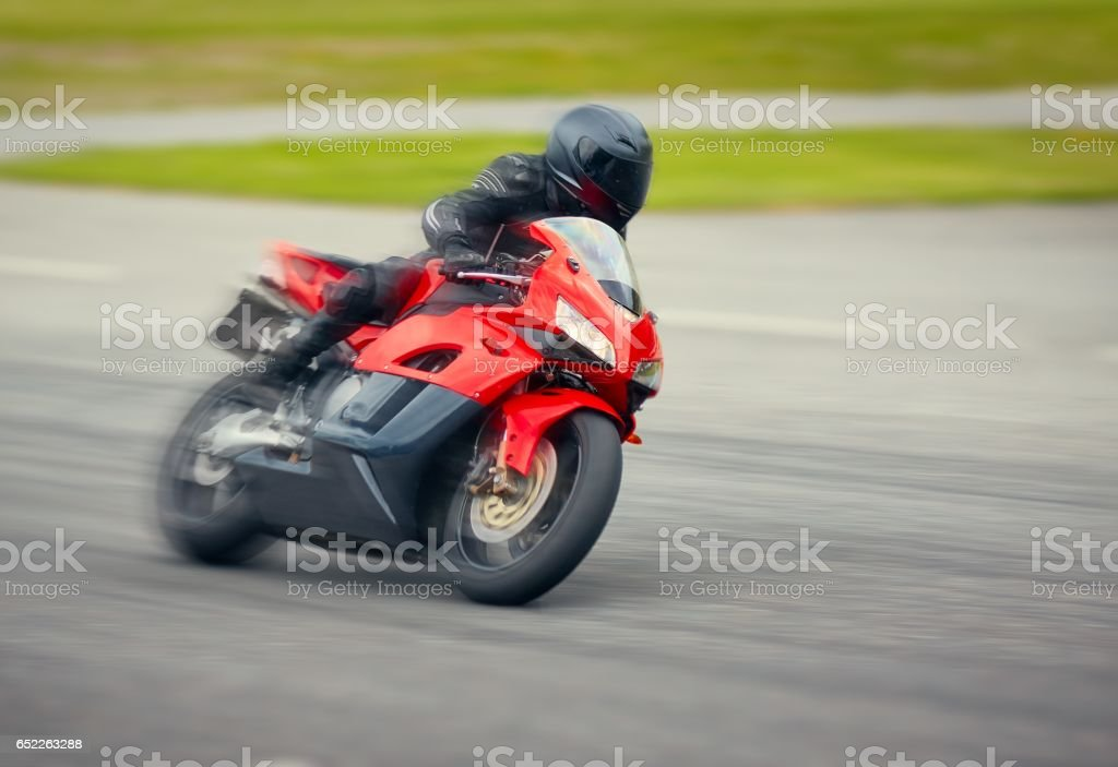 Fast motorbike racing on the race track at high speed. stock photo
