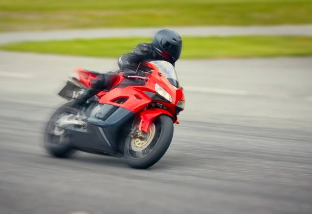 fast motorbike racing on the race track at high speed. - bike tire tracks foto e immagini stock