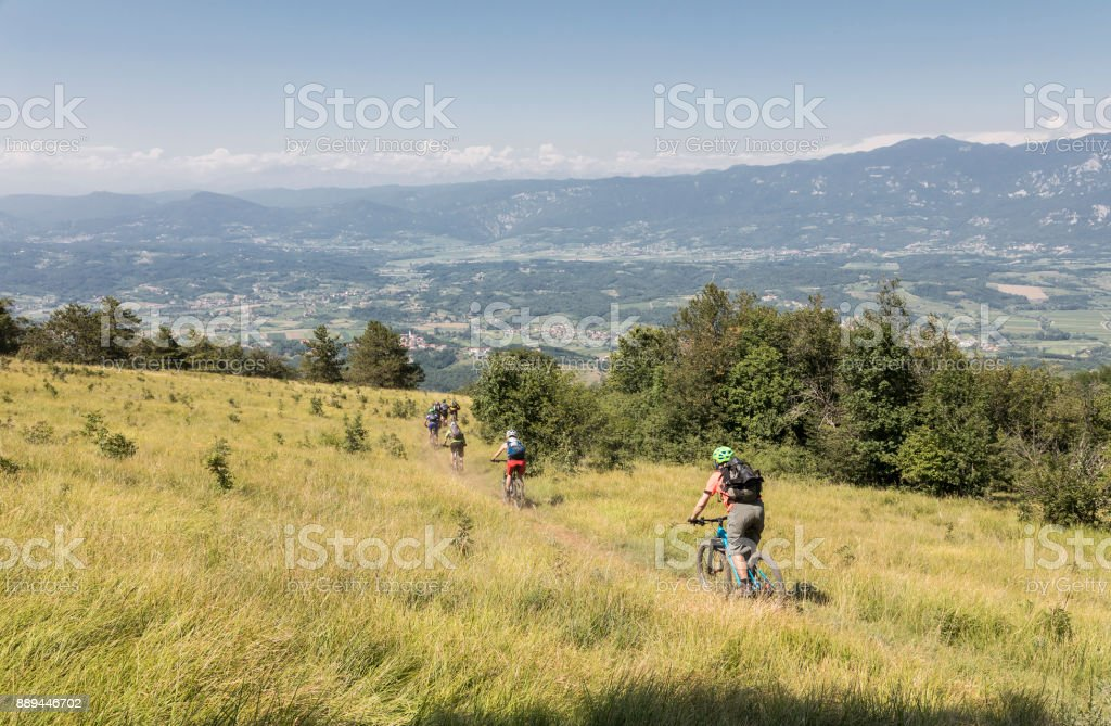 Fast mountainbike downhill in the Slovenian hills. stock photo