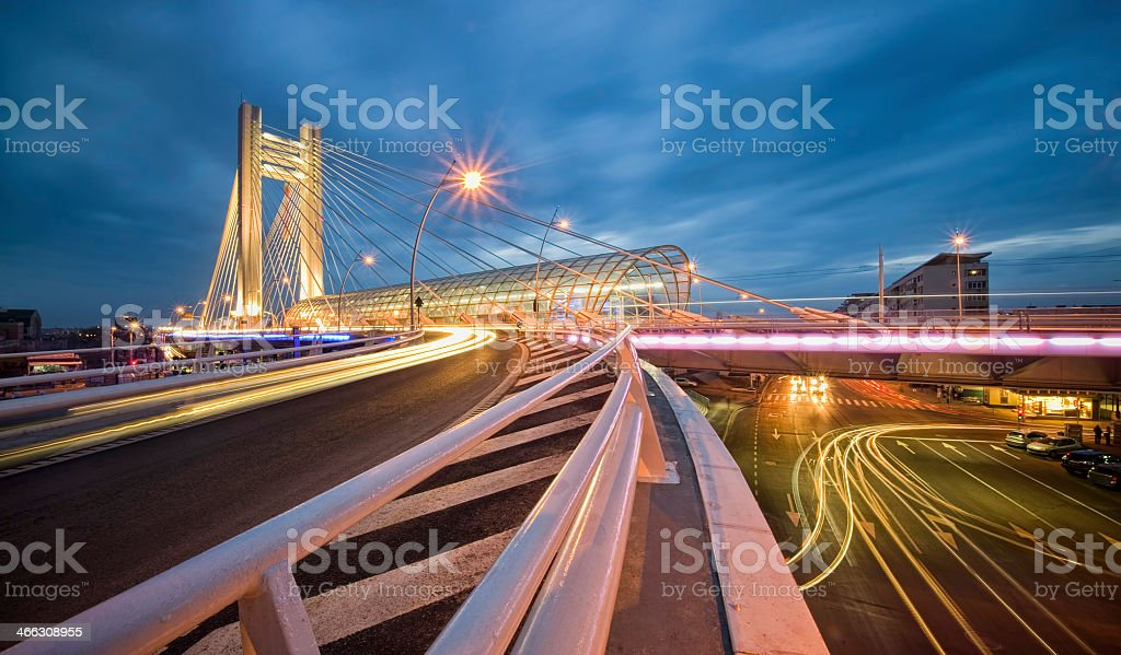 Fast moving city traffic at dusk stock photo