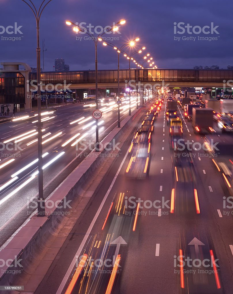 Fast moving color car lights on night highway royalty-free stock photo