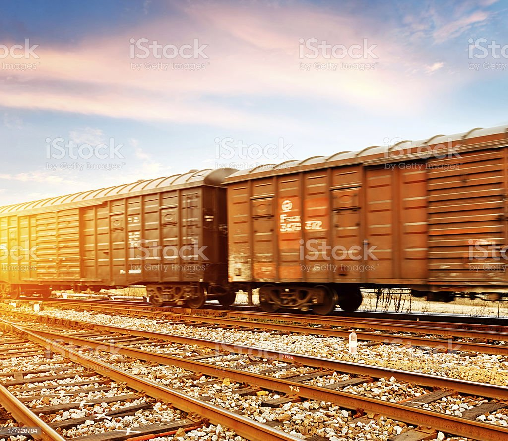 Fast Moving Freight Train Drawing Out Of The Station Stock Photo