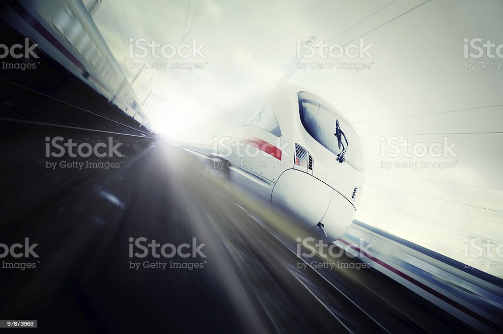 fast moving high speed passenger train stock photo
