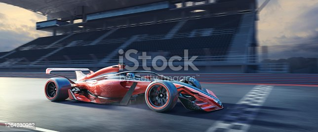 A close up image of a generic racing car moving at high speed over the finish line of a racetrack. The red, white and black racing car is driving on at a generic location, close to an empty grandstand under an overcast sky at evening / sunrise. With motion blur.