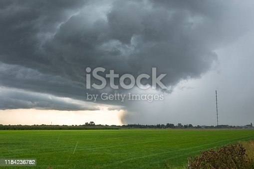 858837068istockphoto Fast moving thunderstorm over the green, wide open landscape of Holland 1184236782