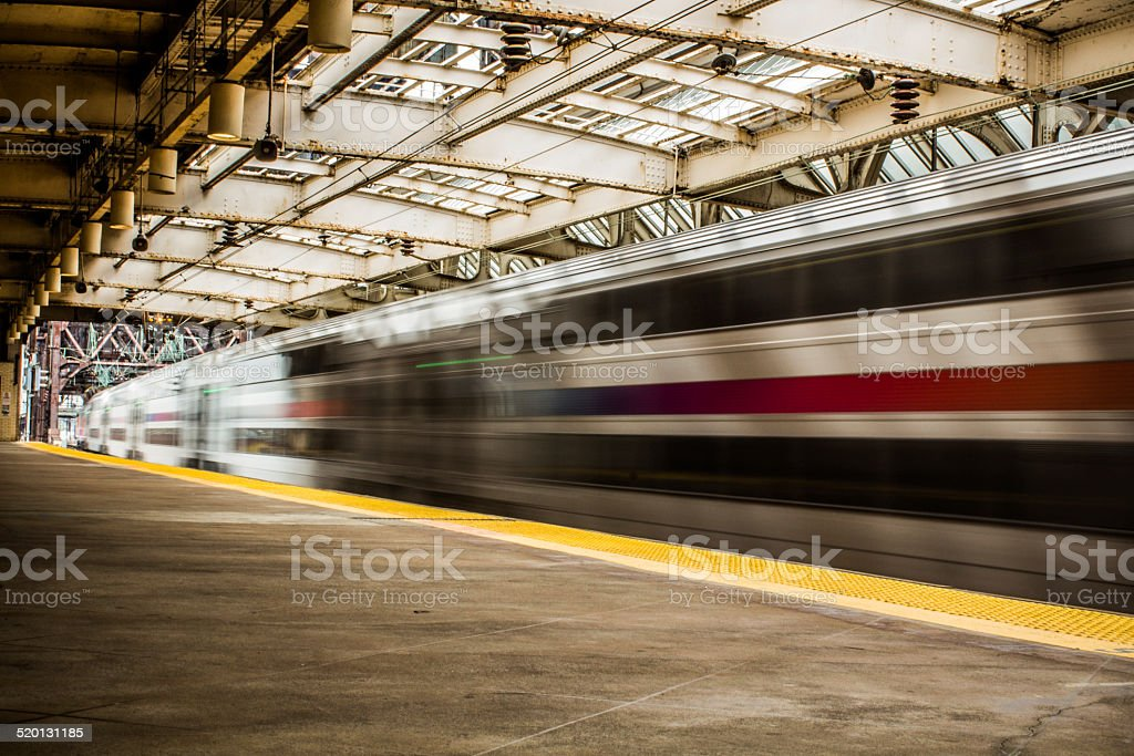 Fast moving train at a train station stock photo