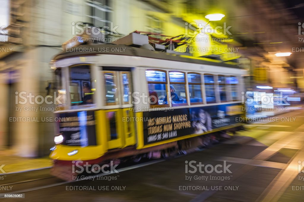 Fast Moving Tram in a Lisbon Street at Night stock photo