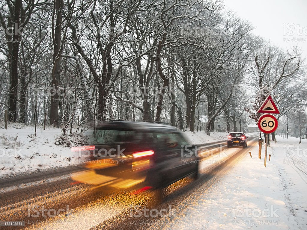 fast moving van brakes in a snow storm stock photo
