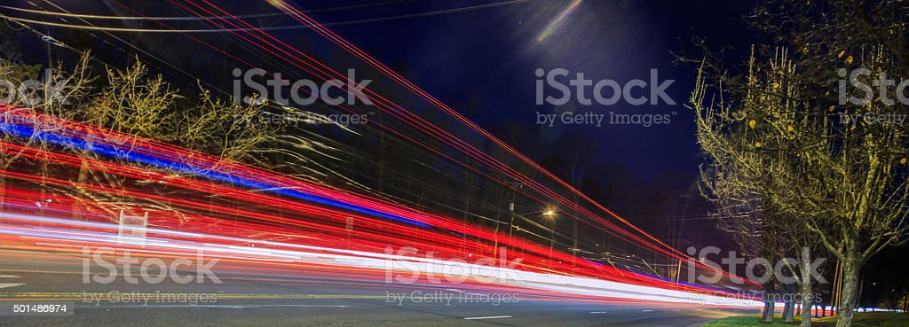 Fast moving vehicle at night stock photo