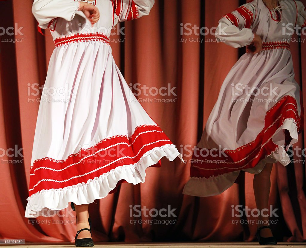Fast Russian folk dance with red-white girls skirts royalty-free stock photo