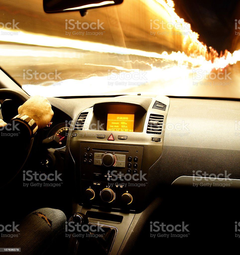 Fast speed night car driving on the light traffic. Interior stock photo