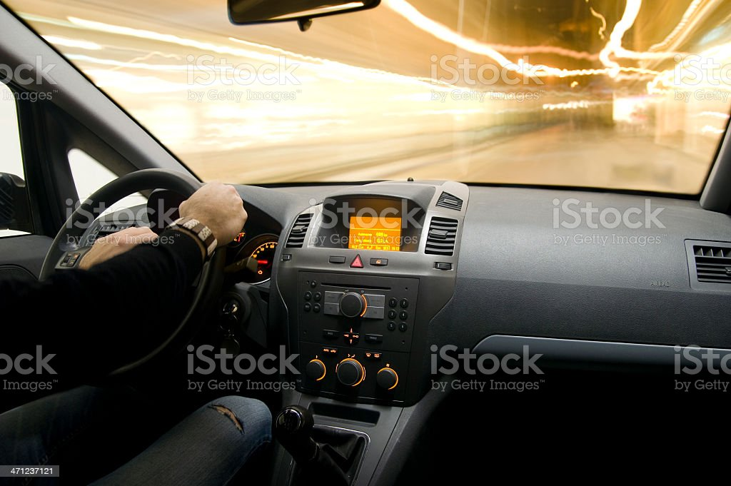Fast speed night car driving on the light traffic Interior royalty-free stock photo