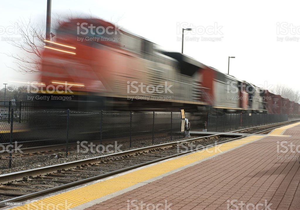 A fast speeding train passing with a blur royalty-free stock photo