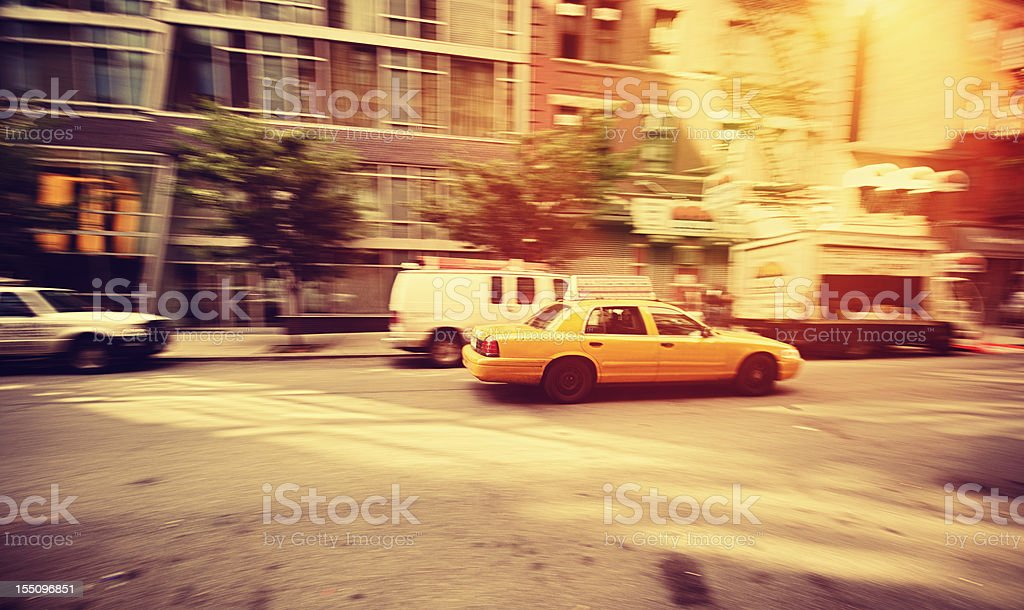Fast Taxi cab panning in Manhattan street at Susent royalty-free stock photo