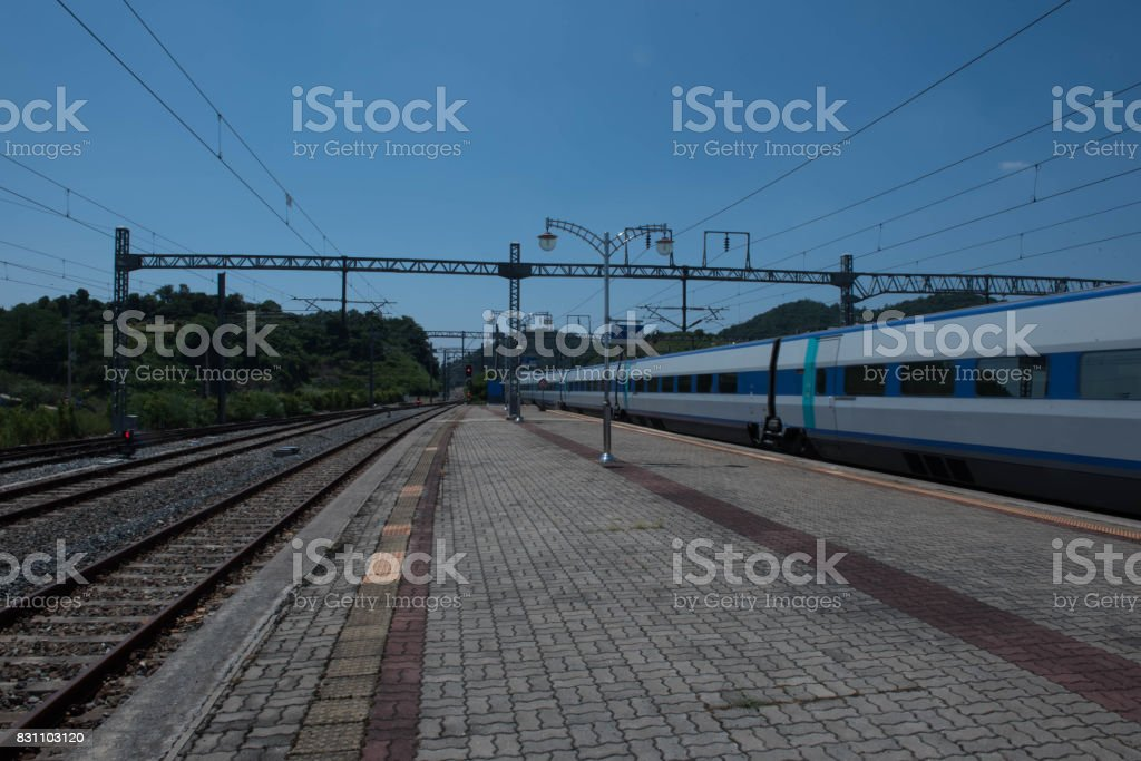 Fast train and train station stock photo
