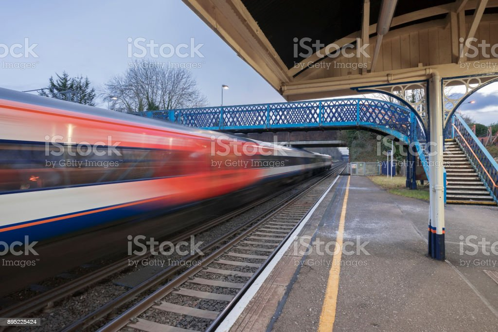 Fast train passing through a station