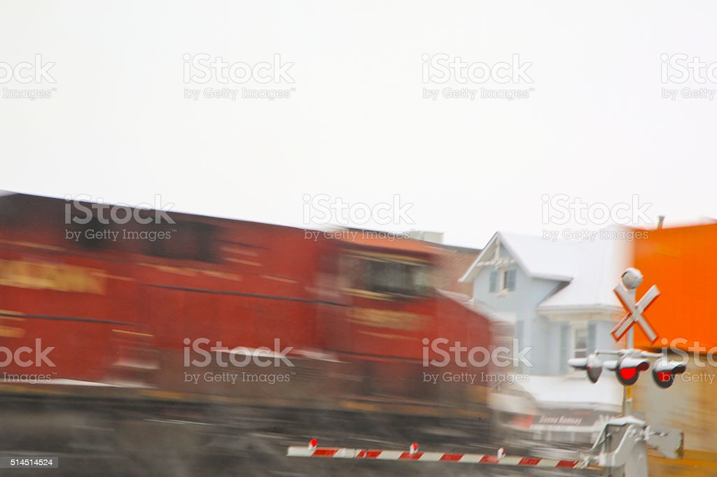 Fast Train Speeding Through a Level Crossing stock photo