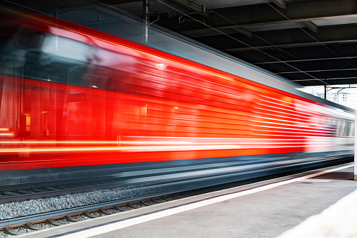 Speeding train through a European Station